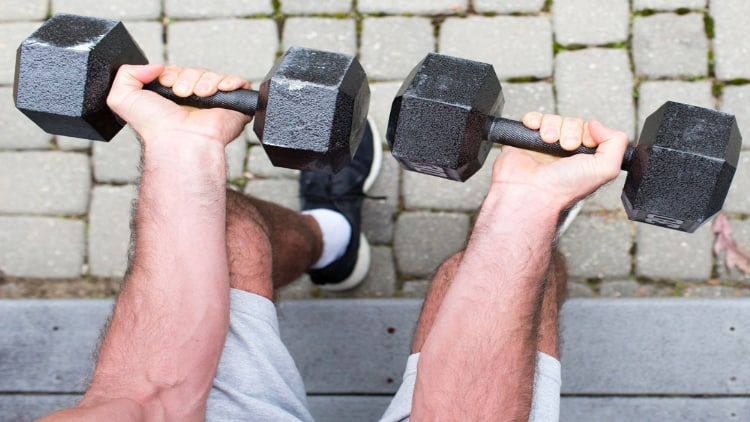 Man doing seated forearm curls