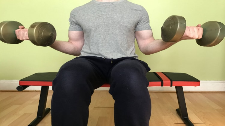 Man doing seated Zottman curls