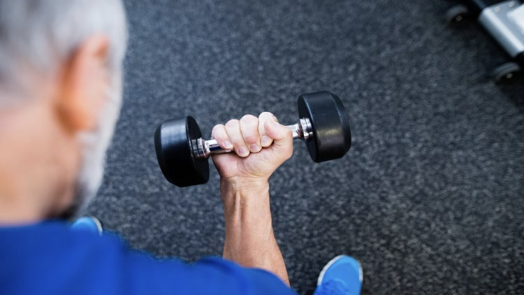 Senior holding a dumbbell in his hand