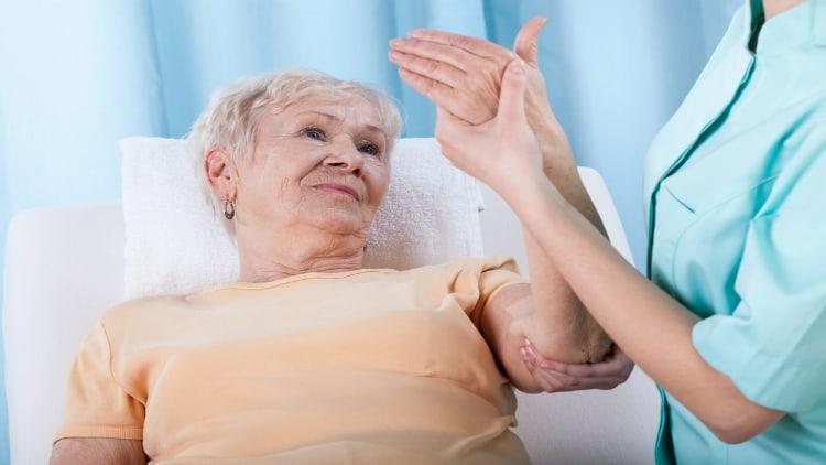 Senior woman with forearm pain