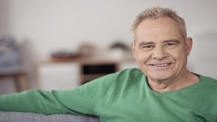 A senior man sitting on the sofa