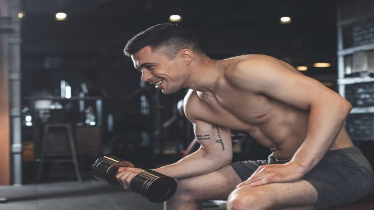 Man performing a single arm dumbbell wrist curl