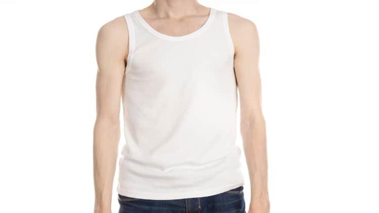 Skinny guy in a white vest