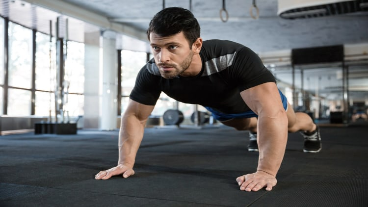 Sportsman doing push ups at the gym