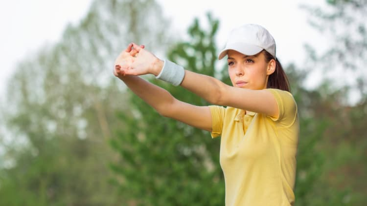 Sportswoman stretching her arms
