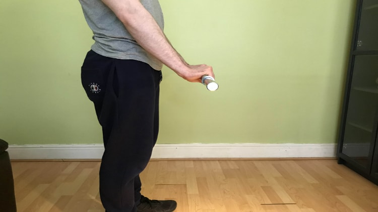 Man performing a standing reverse wrist curl