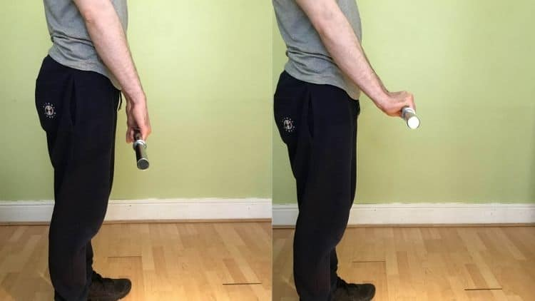 A demonstration of the standing reverse wrist curl exercise