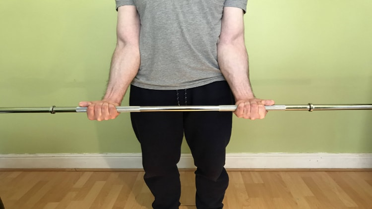 The contracted position during a standing wrist curl
