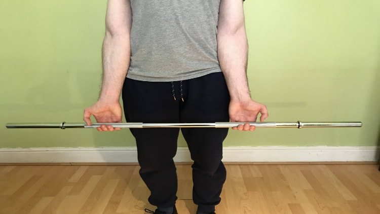 The starting position of a standing wrist curl