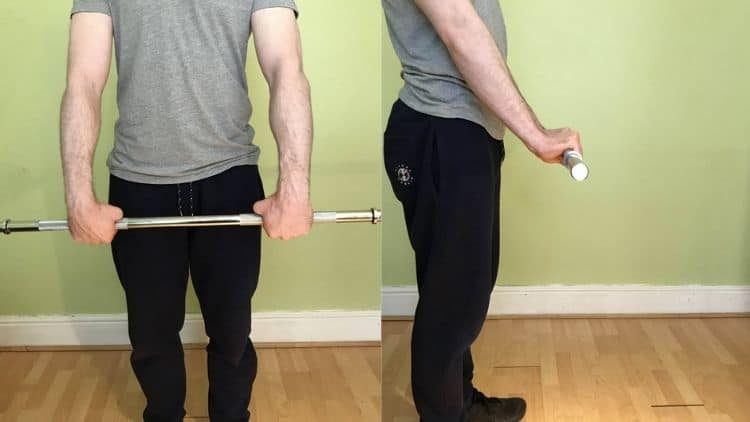 A man performing a standing forearm curl superset