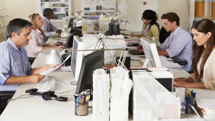 Team working at their office desks