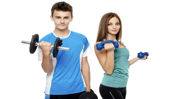 Two teenagers lifting weights