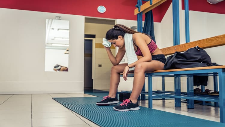 Tired woman in the changing room after a workout