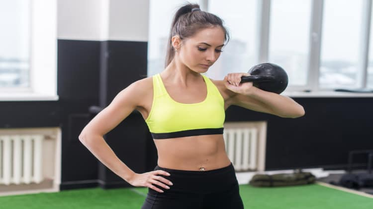 Sporty woman holding a kettlebell