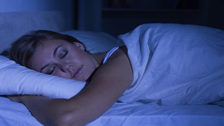 A woman sleeping at night
