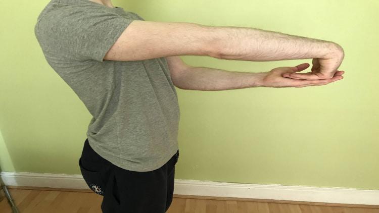 Man performing a wrist extensor stretch