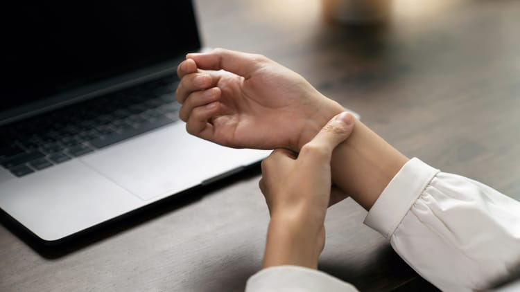 Woman with wrist pain from typing