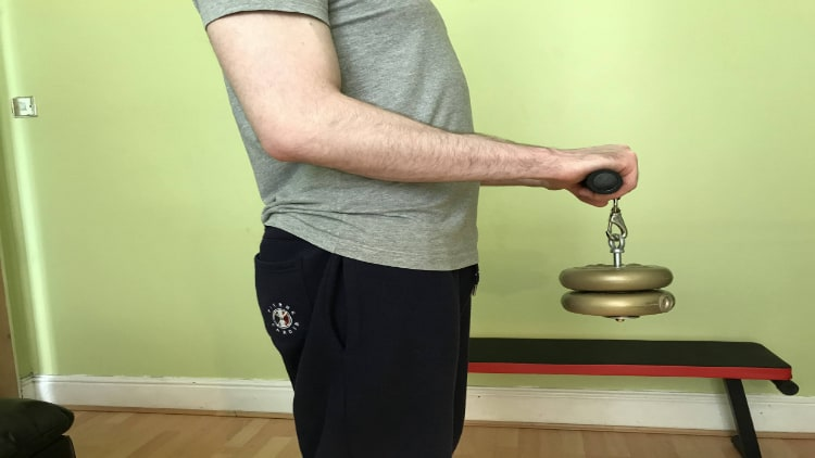 Person performing the wrist roller exercise