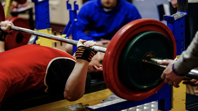 Powerlifter performing a bench press during a powerlifting meet