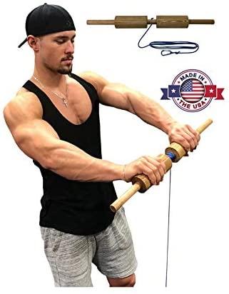 A muscular man using the Core Prodigy Wrist Blaster