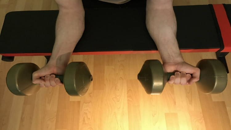 Overhead view of a man doing prone wrist curls