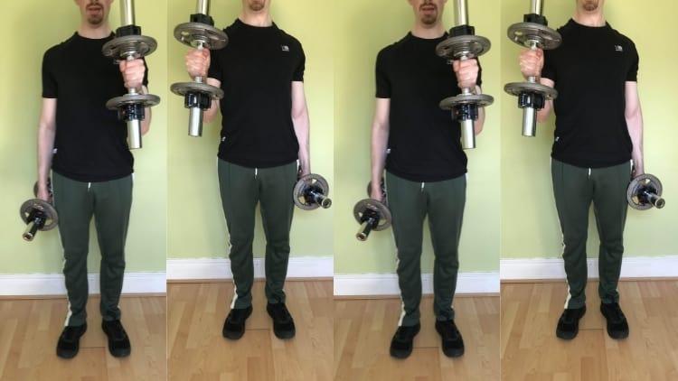 A man doing 112 hammer curls