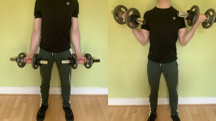 A man doing bicep curls with his back against the wall