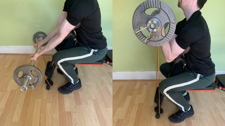 A man performing banded preacher curls