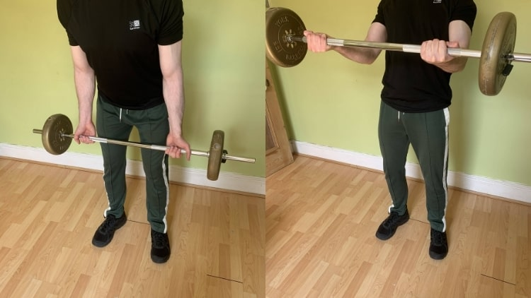 A man performing barbell cheat curls for his biceps