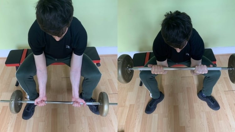 Man performing the barbell concentration curl