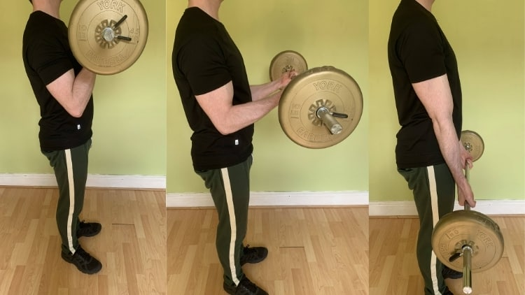 A man performing a barbell negative curl