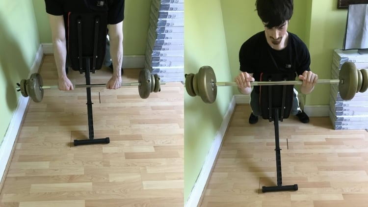 A man performing a barbell reverse spider curl
