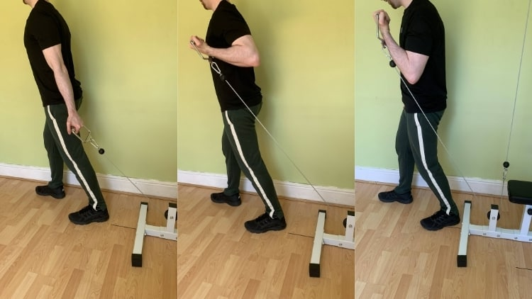 Man performing a bayesian cable curl for his biceps