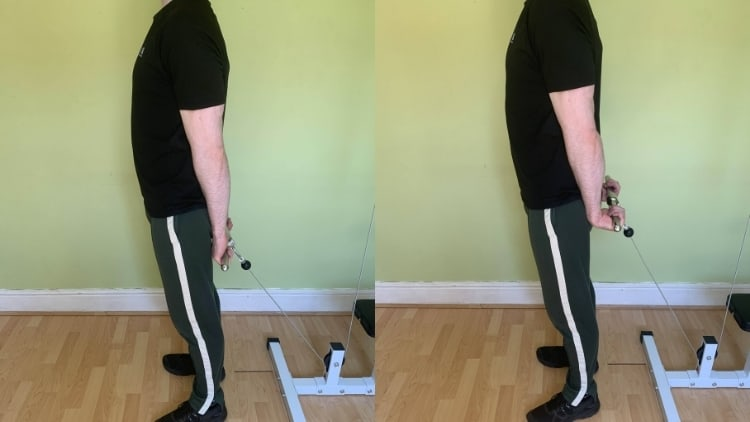 A man doing behind the back cable wrist curls