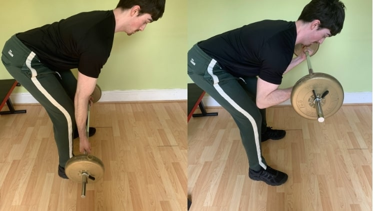 Man performing a bent over barbell concentration curl