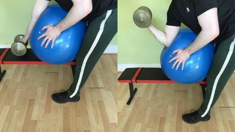 A man doing bicep curls on an exercise ball