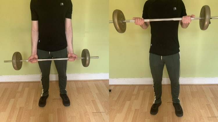 A man performing a bicep drag curl with a barbell