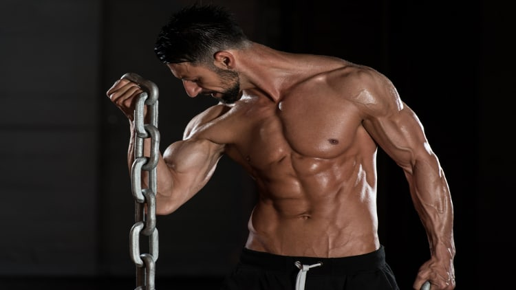 Man doing bicep curls with chains