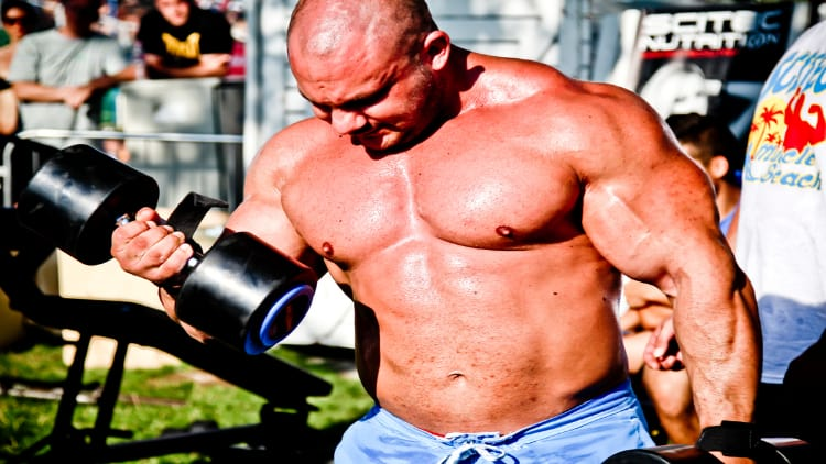 Strongman doing a bicep curl