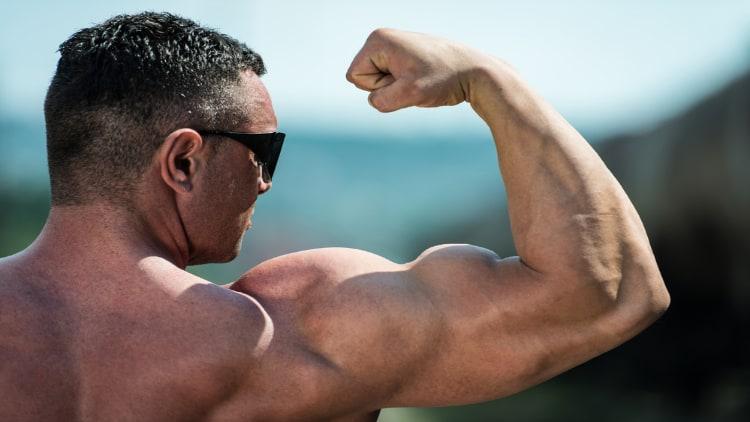 The bicep peak of a bodybuilder