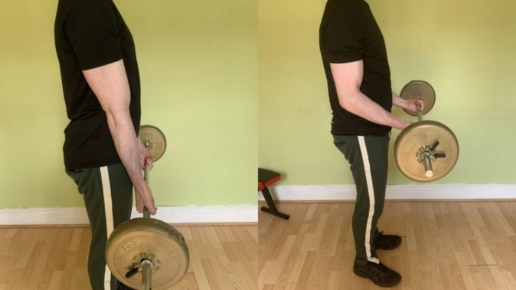 A man performing bottom half curls for his biceps