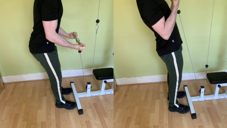 Man using momentum to lift the weight during a cable curl exercise