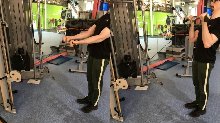 A man doing some cable EZ bar curls