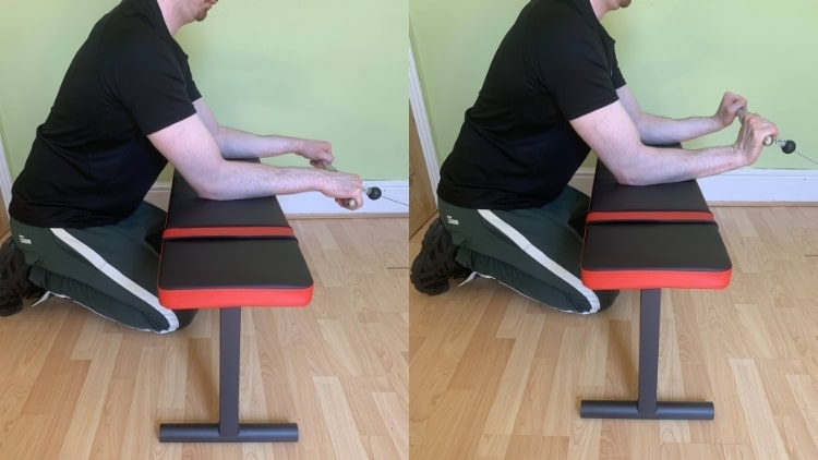 A man performing a cable forearm workout