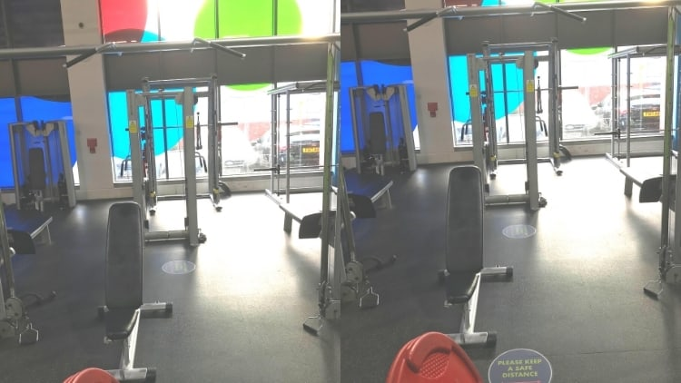 A weight bench next to a cable crossover system