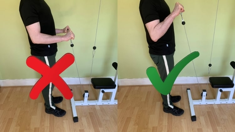 A man showing the proper cable reverse curl form