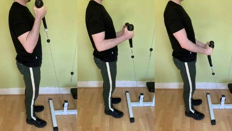Man doing cable rope curls for his biceps