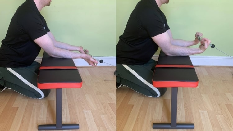 A man doing a cable wrist curl for his forearms