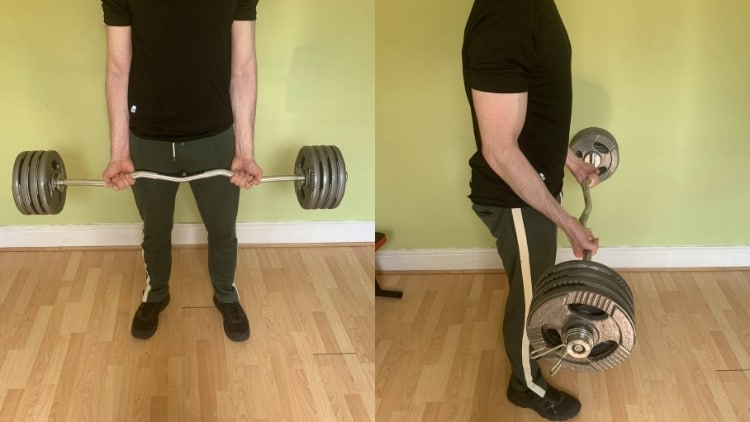 A man doing a cambered bar curl exercise
