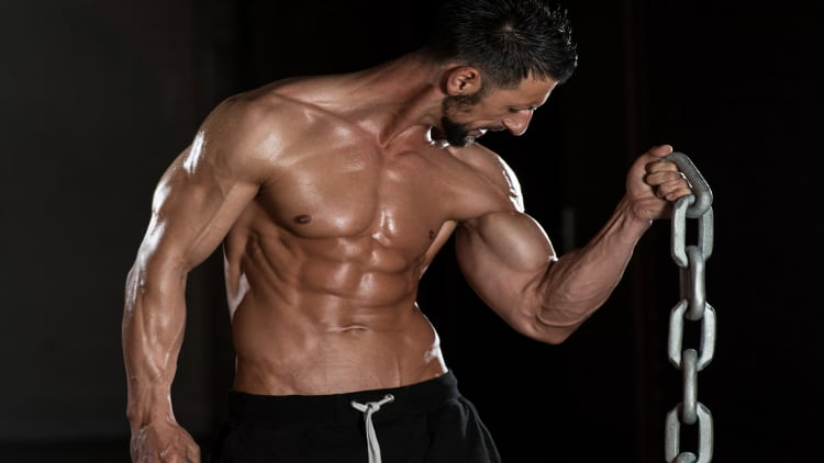 Fitness model doing a chain bicep curl